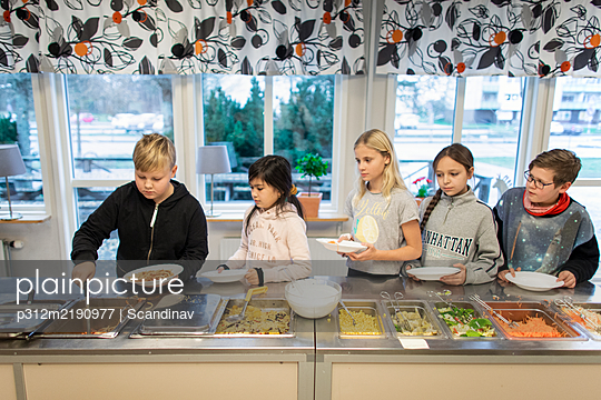 Children choosing food in school canteen - p312m2190977 by Scandinav
