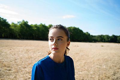 Girl in blue coat in the field - p1096m1051341 by Rajkumar Singh
