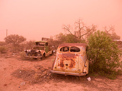 Car wreck in sand storm - p1016m792505 by Jochen Knobloch