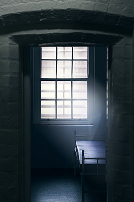 Empty room with bed in mental asylum - p1280m2195454 by Dave Wall
