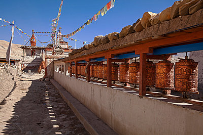 Nepal, Mustang, Lo Manthang. Prayer wheels in the ancient capital of Lo Manthang. - p652m941665 by Katie Garrod