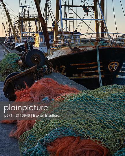 Trawlers alongside and nets, Newlyn, Cornwall, England, United Kingdom - p871m2113948 by Baxter Bradford