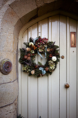 Seasonal wreath on front door of 1840s Victorian school house conversion - p349m789696 by Brent Darby