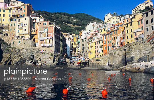 Riomaggiore, view from the sea - p1377m1235390 by Matteo Carassale