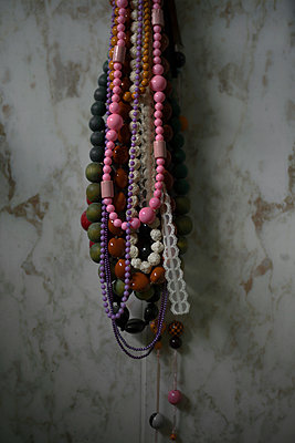 Necklaces and marble wall - p1028m1152494 by Jean Marmeisse