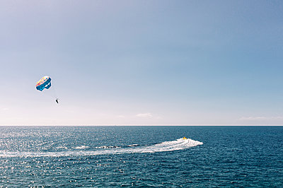 Paragliding over the sea - p1085m1163051 by David Carreno Hansen