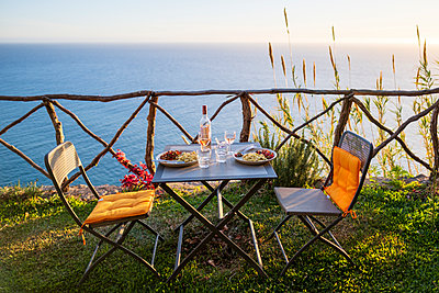 Portugal, Madeira, Table for two - p1600m2175646 by Ole Spata