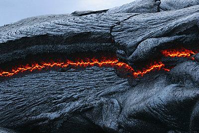 USA, Hawaii, Big Island, Pahoehoe volcano, burning lava flow, close up - p30017491f by Martin Rietze