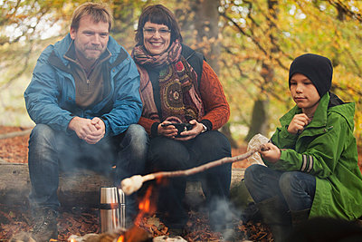 Family camping in forest - p426m920329f by Malin Holm