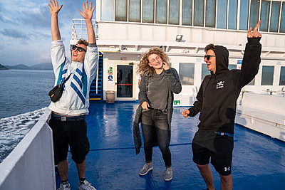 Three young adults on a ship - p1437m2151284 by Achim Bunz
