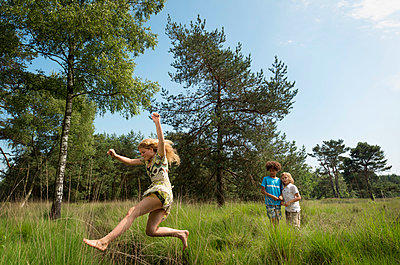 Kids play in the woods - p1132m1152749 by Mischa Keijser