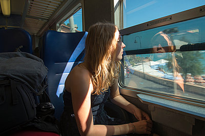 Girl in a train - p161m940570 by Kerstin Schomburg