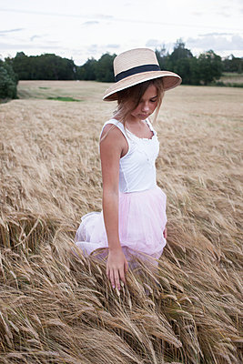 Girl on rye field - p312m1471855 by Christina Strehlow