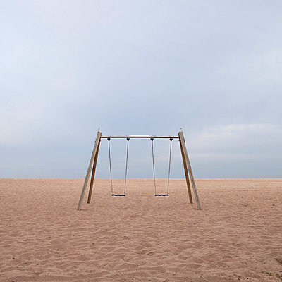 Swings on the beach front In Barcelona  - p1072m829079 by Joan Seculi