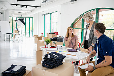 Business owners working in new office space - p1192m2034697 by Hero Images