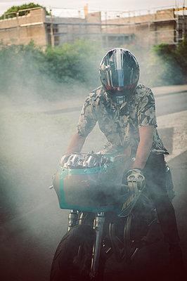 Biker in smoke - p1150m2128695 by Elise Ortiou Campion