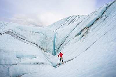 Male hiker on Root Glacier Wrangell St. Elias National Park and Preserve near McCarthy, Alaska - p343m1475643 by Cavan Images