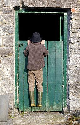 Boy hanging on Door - p1082m1071880 by Daniel Allan