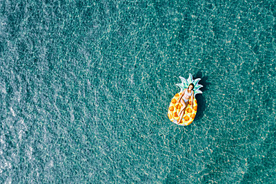 Woman on air mattress in the sea, drone photography - p713m2289240 by Florian Kresse