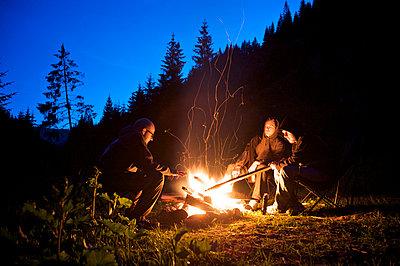 Friends by the campfire - p1980176 by David Breun