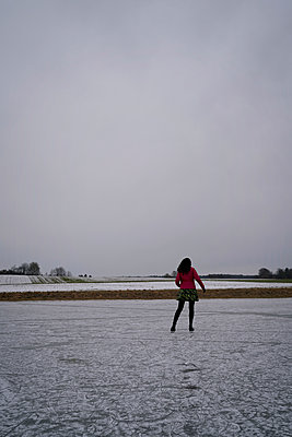 Ice skating on a frozen meadow  - p470m2284182 by Ingrid Michel