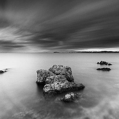 Long exposure shot of sea stacks in the morning at Morito beach, Miura Peninsula, Japan - p1166m2201383 by Cavan Images