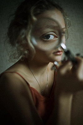 Eye of a girl seen through a magnifying glass - p1642m2216170 by V-fokuse