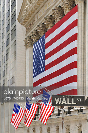 American flag hanging at Stock Exchange building - p575m743733 by Henrik Karlsson