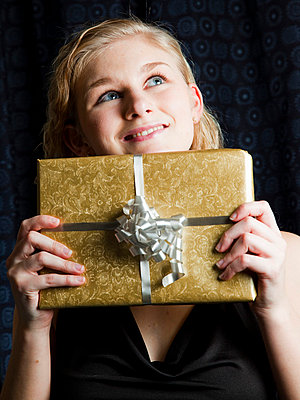 Woman with a present - p4130720 by Tuomas Marttila
