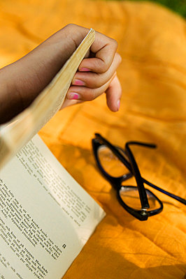 Book and reading glasses - p972m667767f by Snow photography