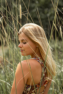 Blond woman in the meadow - p1640m2254648 by Holly & John
