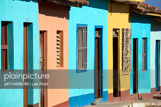 Row of colonial houses painted bright colours