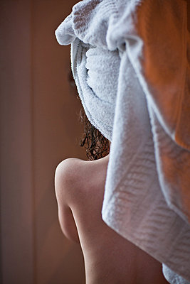 Woman With Hair Wrapped in Towel, Rear View - p6943795 by Olle Nordell