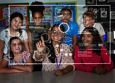 Teacher and junior high school students using futuristic touch screen in classroom - p1023m2067251 by Robert Daly