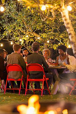 Friends enjoying dinner garden party - p1023m2087999 by Paul Bradbury