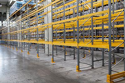 Metallic racks in warehouse - p1166m2011756 by Cavan Images