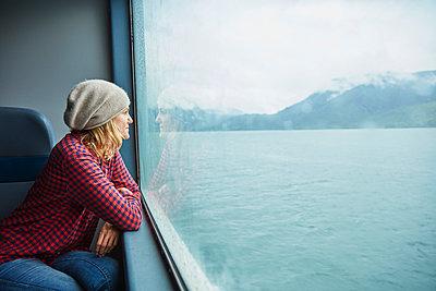 Chile, Hornopiren, woman looking out of window of a ferry - p300m2069187 by Stefan Schütz