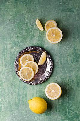 Lemon slices on silver plate - p300m2081012 by Mandy Reschke