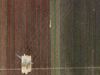 Aerial view of electricity pylon in agricultural field, Stuttgart, Baden-Wuerttemberg, Germany - p301m1406281 by Stephan Zirwes
