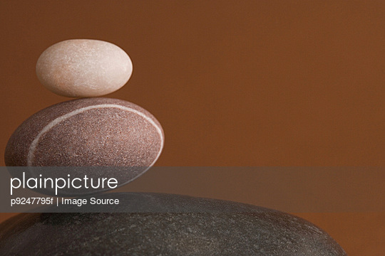 Stack of pebbles - p9247795f by Image Source