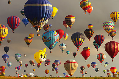 Hot-air balloons in the air (Composite image) - p719m1132693 by Rudi Sebastian