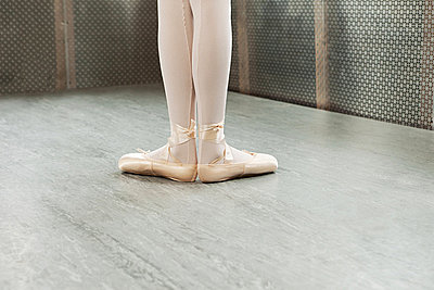 Feet of ballerina in first position - p9245510f by Image Source