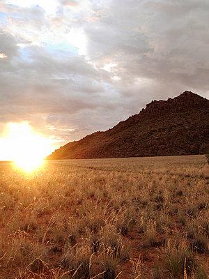Sunset in the desert of Namibia - p8870044 by Christian Kuhn