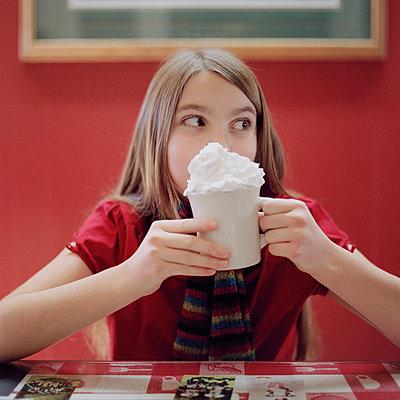 A teenage girl holding a mug of hot chocolate - p30119953f by Heidi Yount