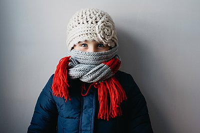 Girl warmly wrapped up in woollen hat and scarf - p429m1021774f by Hugh Whitaker
