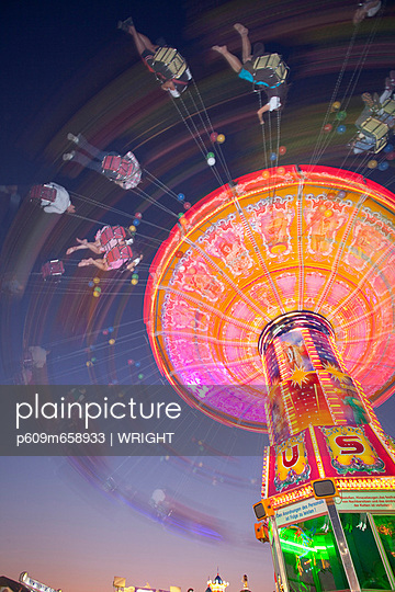 Illuminated fairground rides at night, Oktoberfest, Munich, Germany - p609m658933 by WRIGHT