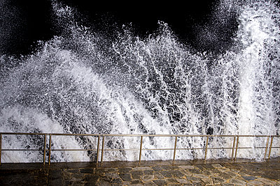 Night time waves lit with strobe lighting - p1201m1463390 by Paul Abbitt