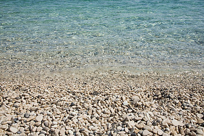 Pebble beach and sea - p9249335f by Image Source