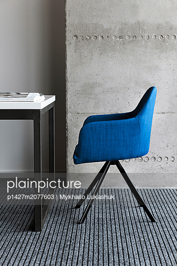 Blue chair by desk - p1427m2077603 by Mykhailo Lukashuk