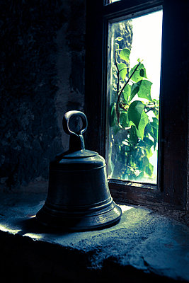Bell behind a window - p1062m794420 by Viviana Falcomer